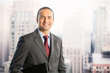 portrait - Portrait of confident businessman in urban window Stock Photo - Premium Royalty-Free, Code: 6113-07648729