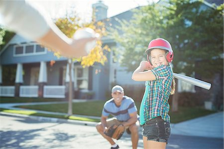 Family playing baseball in street Stock Photo - Premium Royalty-Free, Code: 6113-07648858