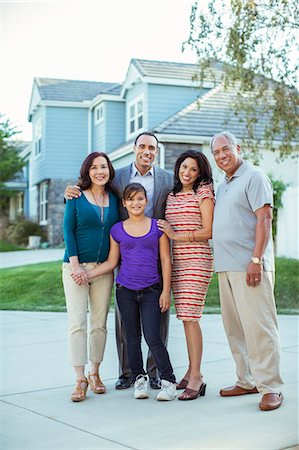 preteen girl boyfriends - Portrait of multi-generation family in driveway Stock Photo - Premium Royalty-Free, Code: 6113-07648869