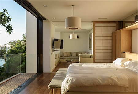 Sunny modern bedroom Stock Photo - Premium Royalty-Free, Code: 6113-07648953