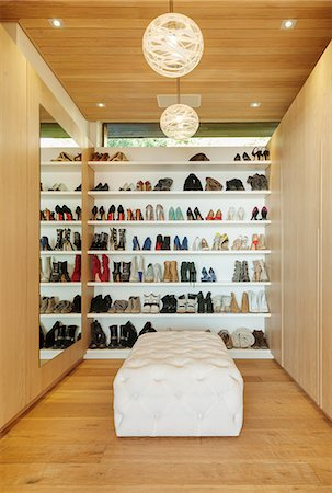 Modern walk-in closet with shoes on shelves Stock Photo - Premium Royalty-Free, Code: 6113-07648950