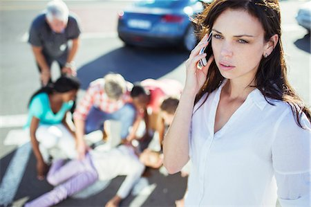 Woman calling emergency services at car accident Stock Photo - Premium Royalty-Free, Code: 6113-07761959