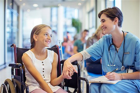 Nurse holding patient's hands in hospital Stock Photo - Premium Royalty-Free, Code: 6113-07762048