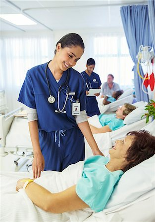 doctor and patient - Nurse talking to patient in hospital room Stock Photo - Premium Royalty-Free, Code: 6113-07762078