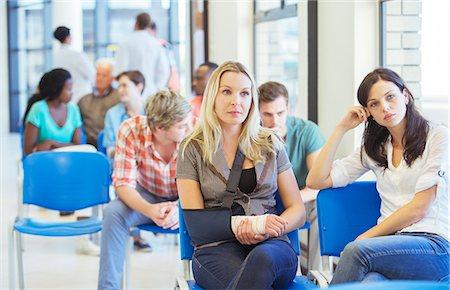 Women sitting in hospital waiting room Stock Photo - Premium Royalty-Free, Code: 6113-07762015