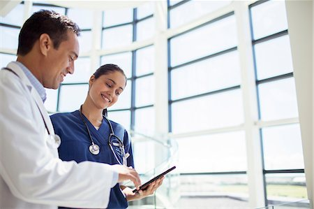 doctor and patient - Doctor and nurse reading medical chart in hospital Stock Photo - Premium Royalty-Free, Code: 6113-07762022