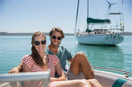 Couple sitting in boat on water Stock Photo - Premium Royalty-Free, Code: 6113-07762157