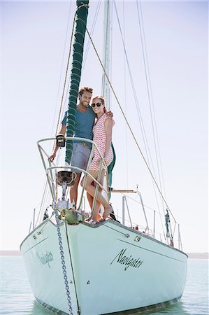 Couple standing on front of boat Stock Photo - Premium Royalty-Free, Code: 6113-07762165