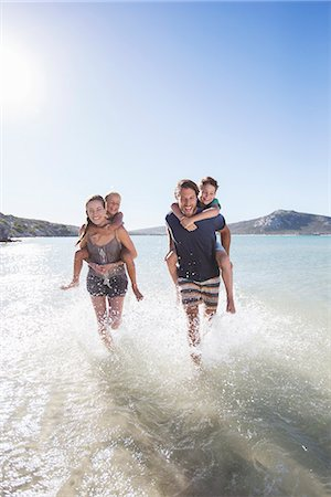 families playing on the beach - Family running in water on beach Stock Photo - Premium Royalty-Free, Code: 6113-07762184