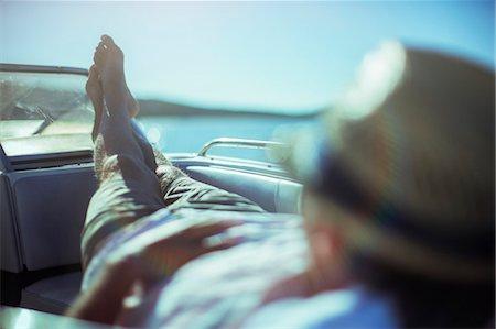 Man relaxing on boat near beach Stock Photo - Premium Royalty-Free, Code: 6113-07762113