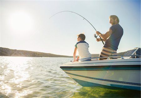 fishing - Father and son fishing on boat Stock Photo - Premium Royalty-Free, Code: 6113-07762119