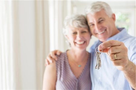 Older man holding keys with wife Stock Photo - Premium Royalty-Free, Code: 6113-07762241