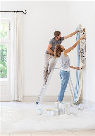 Couple hanging wallpaper together Stock Photo - Premium Royalty-Free, Code: 6113-07762277