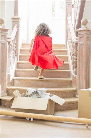 superhero - Young girl running up stairs playing Stock Photo - Premium Royalty-Free, Code: 6113-07762286
