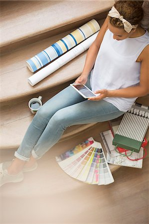 selecting - Woman using digital tablet on stairs surrounded by wall paper and color swatches Stock Photo - Premium Royalty-Free, Code: 6113-07762202