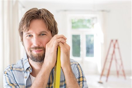 Man smiling in living space Stock Photo - Premium Royalty-Free, Code: 6113-07762211