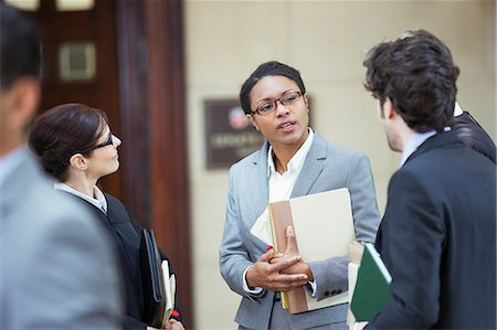 Lawyers talking outside courtroom Stock Photo - Premium Royalty-Free, Code: 6113-07762345