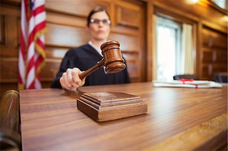 Judge banging gavel in court Stock Photo - Premium Royalty-Free, Code: 6113-07762348