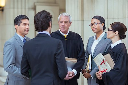 Judges and lawyers talking in courthouse Stock Photo - Premium Royalty-Free, Code: 6113-07762353
