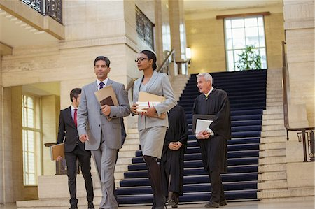 Judges and lawyer walking through courthouse Stock Photo - Premium Royalty-Free, Code: 6113-07762358