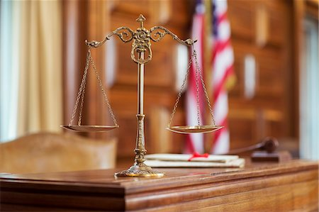 Scales of justice on the judge's bench Stock Photo - Premium Royalty-Free, Code: 6113-07762359