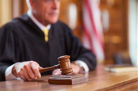 Judge banging gavel in court Stock Photo - Premium Royalty-Free, Code: 6113-07762360