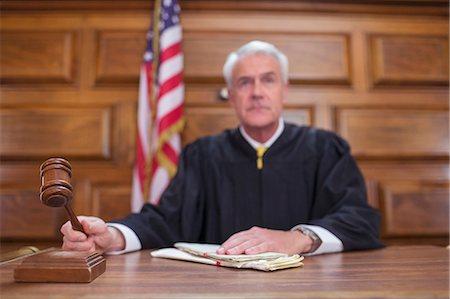Judge banging gavel in court Stock Photo - Premium Royalty-Free, Code: 6113-07762370