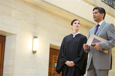 Judge and lawyer talking in courthouse Stock Photo - Premium Royalty-Free, Code: 6113-07762374
