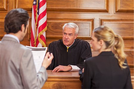 Lawyers pleading case to judge in court Stock Photo - Premium Royalty-Free, Code: 6113-07762375