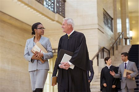 Judge and lawyer walking through courthouse together Stock Photo - Premium Royalty-Free, Code: 6113-07762381