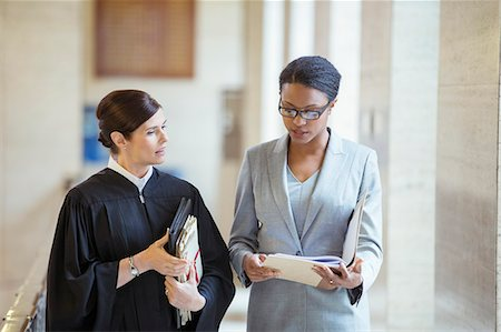 Judge and lawyer talking in courthouse Stock Photo - Premium Royalty-Free, Code: 6113-07762384