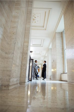Judge and lawyer talking in courthouse Stock Photo - Premium Royalty-Free, Code: 6113-07762386