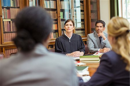 Judge and lawyers talking in chambers Stock Photo - Premium Royalty-Free, Code: 6113-07762391