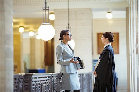 Judge and lawyer talking in courthouse Stock Photo - Premium Royalty-Free, Code: 6113-07762398