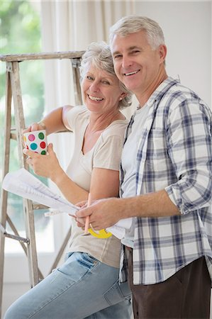 Older couple looking through documents together Stock Photo - Premium Royalty-Free, Code: 6113-07762330