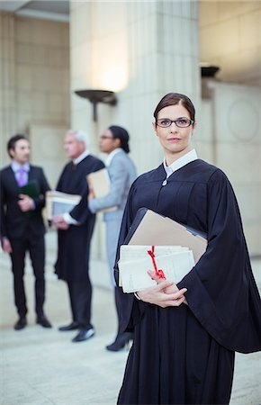 Judge holding legal documents in courthouse Stock Photo - Premium Royalty-Free, Code: 6113-07762443