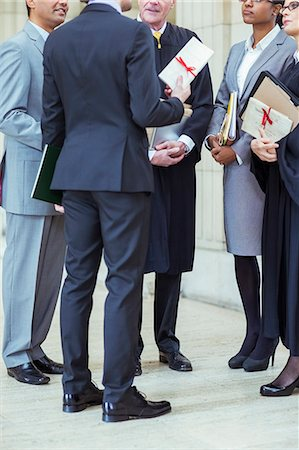 Judges and lawyers talking in courthouse Stock Photo - Premium Royalty-Free, Code: 6113-07762440