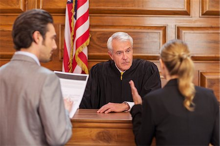 Lawyers pleading case to judge in court Stock Photo - Premium Royalty-Free, Code: 6113-07762463