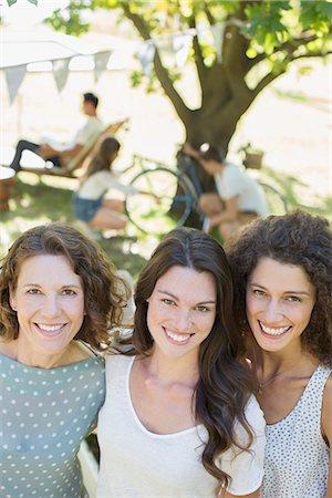 Three women hugging outdoors Stock Photo - Premium Royalty-Free, Code: 6113-07762476