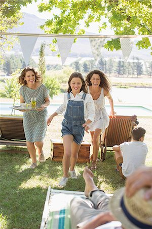 Family running through park together Stock Photo - Premium Royalty-Free, Code: 6113-07762480