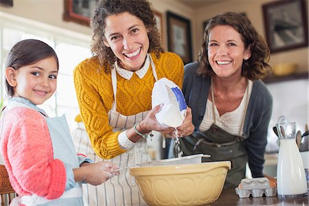 Three generations of women baking together Stock Photo - Premium Royalty-Free, Code: 6113-07762481