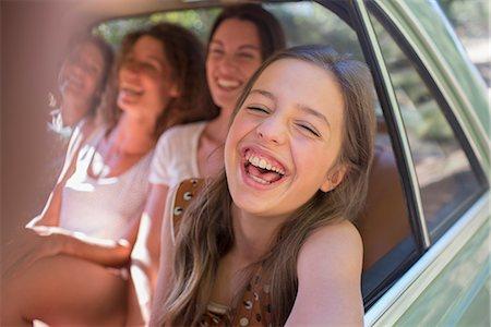 Four women playing in car backseat Stock Photo - Premium Royalty-Free, Code: 6113-07762488