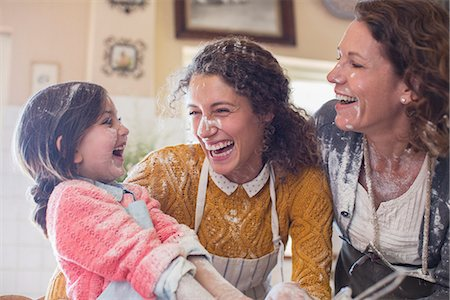 Three generations of women playing in the kitchen Stock Photo - Premium Royalty-Free, Code: 6113-07762495