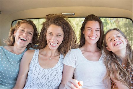 For women sitting in car backseat together Stock Photo - Premium Royalty-Free, Code: 6113-07762496