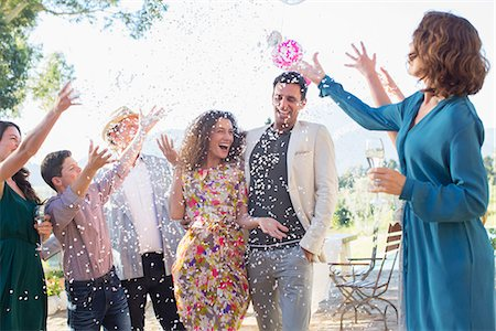 family image and confetti - Family throwing confetti on newlywed couple Stock Photo - Premium Royalty-Free, Code: 6113-07762499