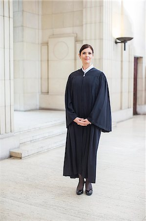 Judge standing in courthouse Stock Photo - Premium Royalty-Free, Code: 6113-07762408