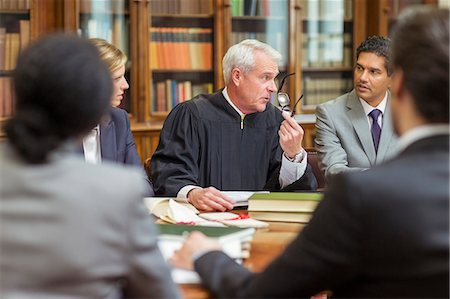 Judge and lawyers talking in chambers Stock Photo - Premium Royalty-Free, Code: 6113-07762413
