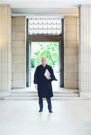 Judge standing in front of doors to courthouse Stock Photo - Premium Royalty-Free, Code: 6113-07762412