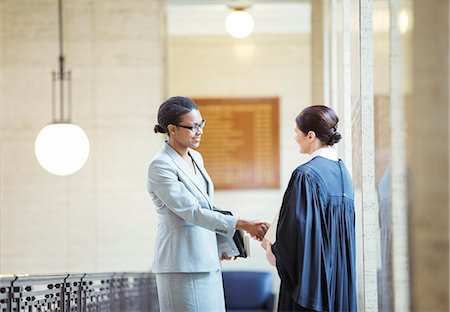Judge and lawyer shaking hands in courthouse Stock Photo - Premium Royalty-Free, Code: 6113-07762417