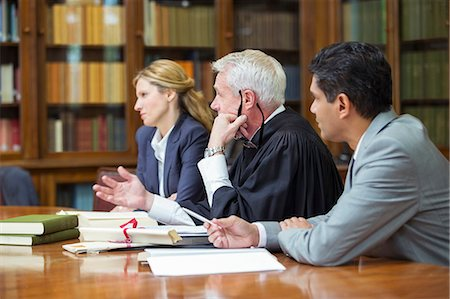 Judge and lawyers talking in chambers Stock Photo - Premium Royalty-Free, Code: 6113-07762415
